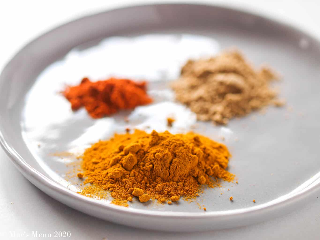 The dried spices for the peanut butter chicken: turmeric, ground red pepper, and coriander