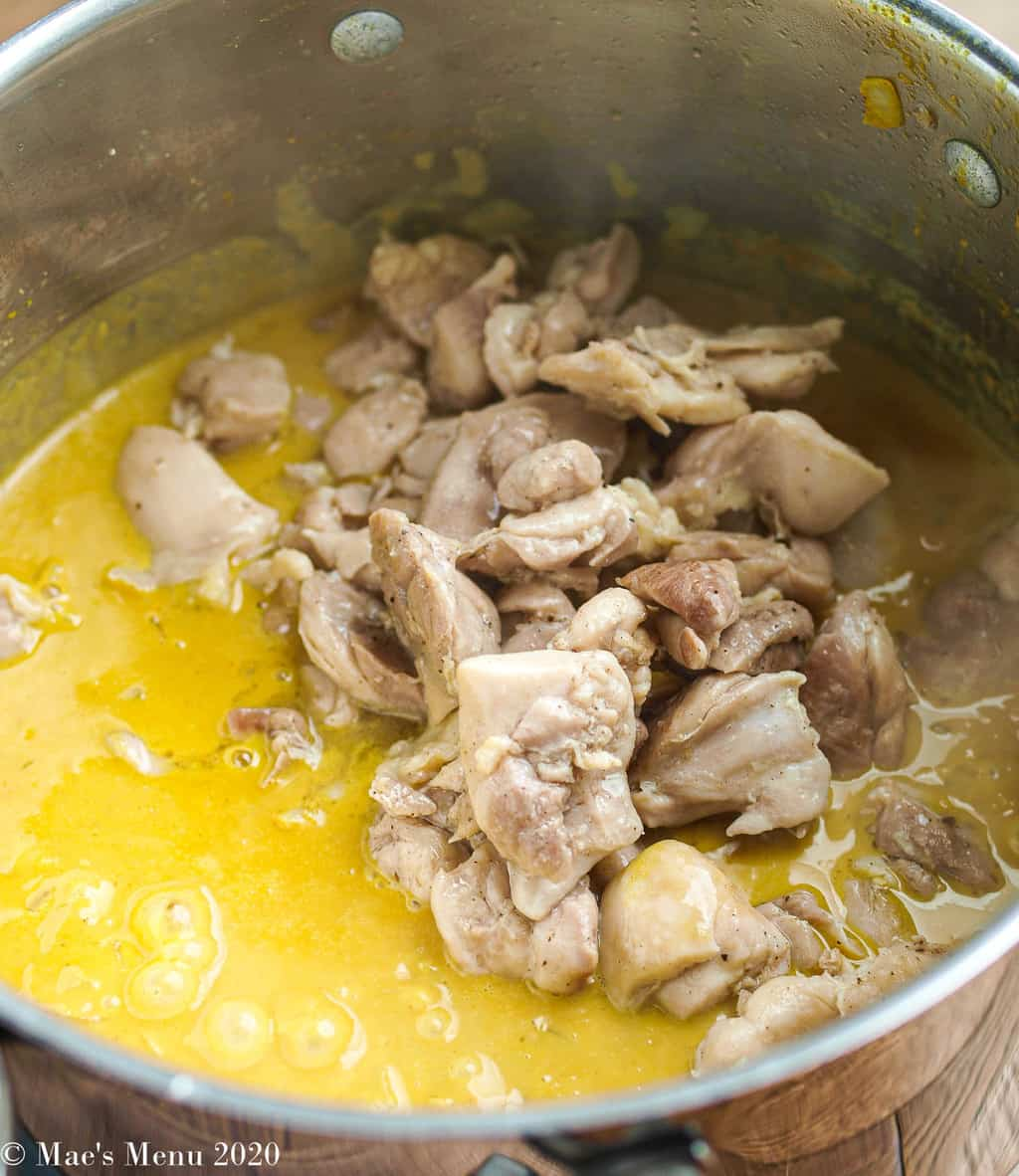 Adding the chicken to the peanut butter curry sauce