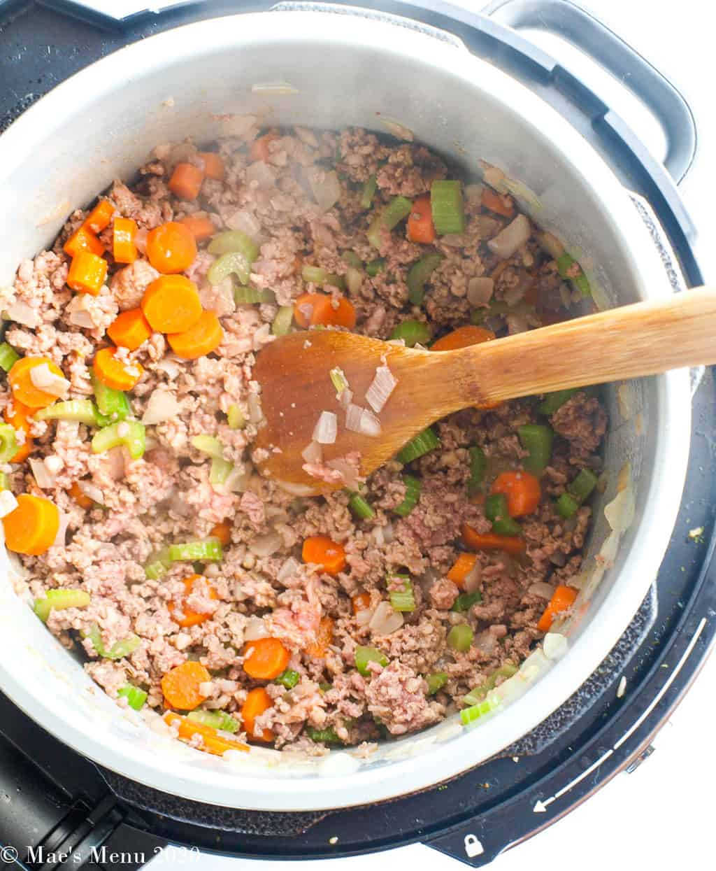 Cooked ground meat and veggies in a pressure cooker