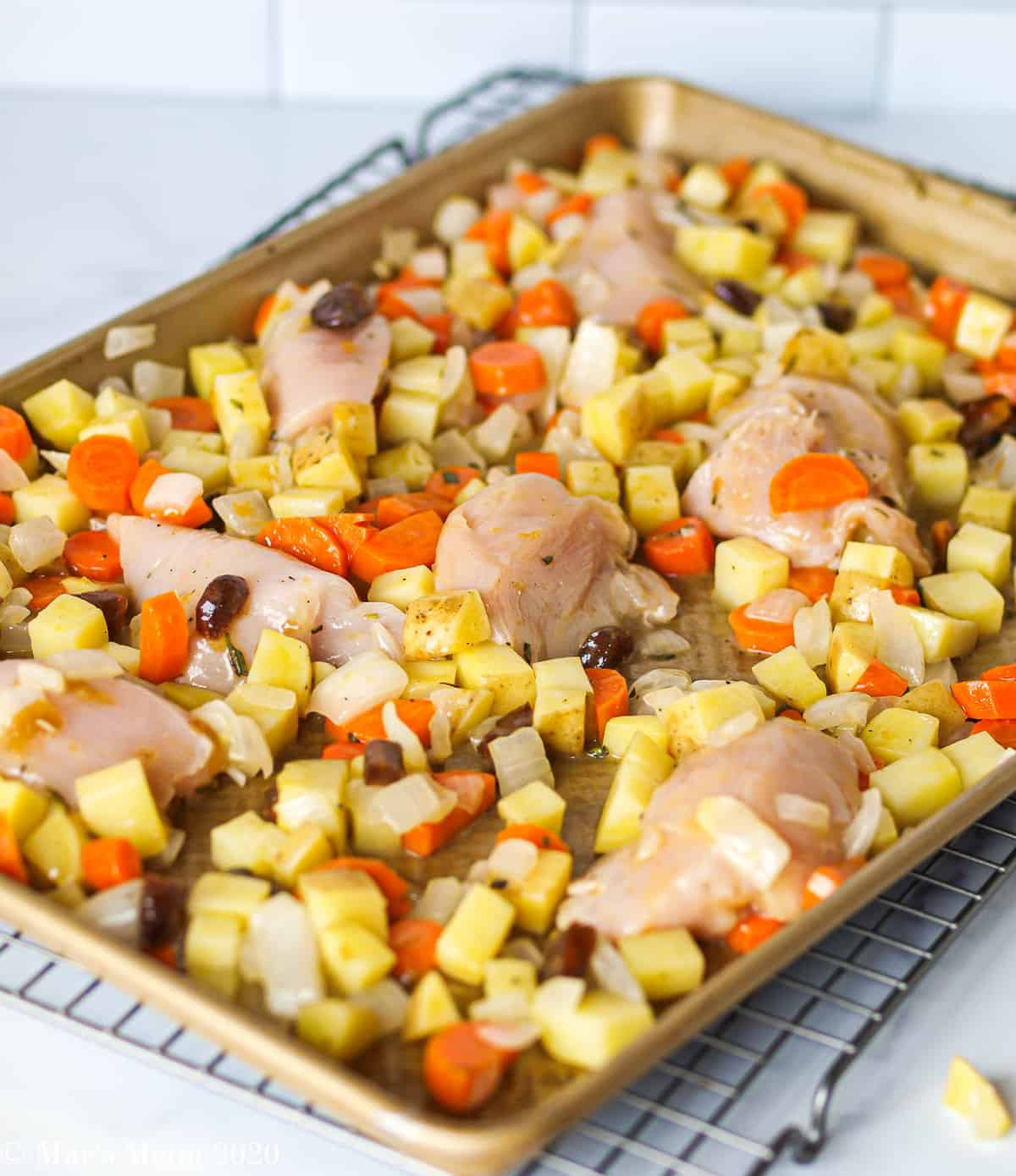 The chicken and apricots mixed into the sheet of roasted veggies