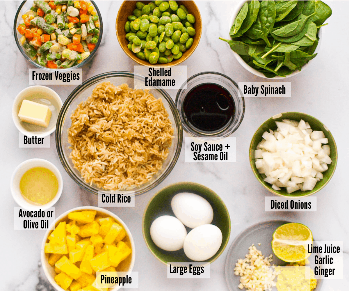 All the ingredients for house special fried rice: frozen veggie blend, shelled edamame, baby spinach, butter, avocado or olive oil, soy sauce, sesame oil, diced onions, pineapple, large eggs, lime juice, garlic, and ginger