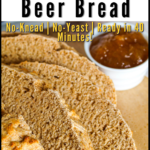 A pinterest pin for whole wheat beer bread with an overhead shot of a sliced loaf of the bread
