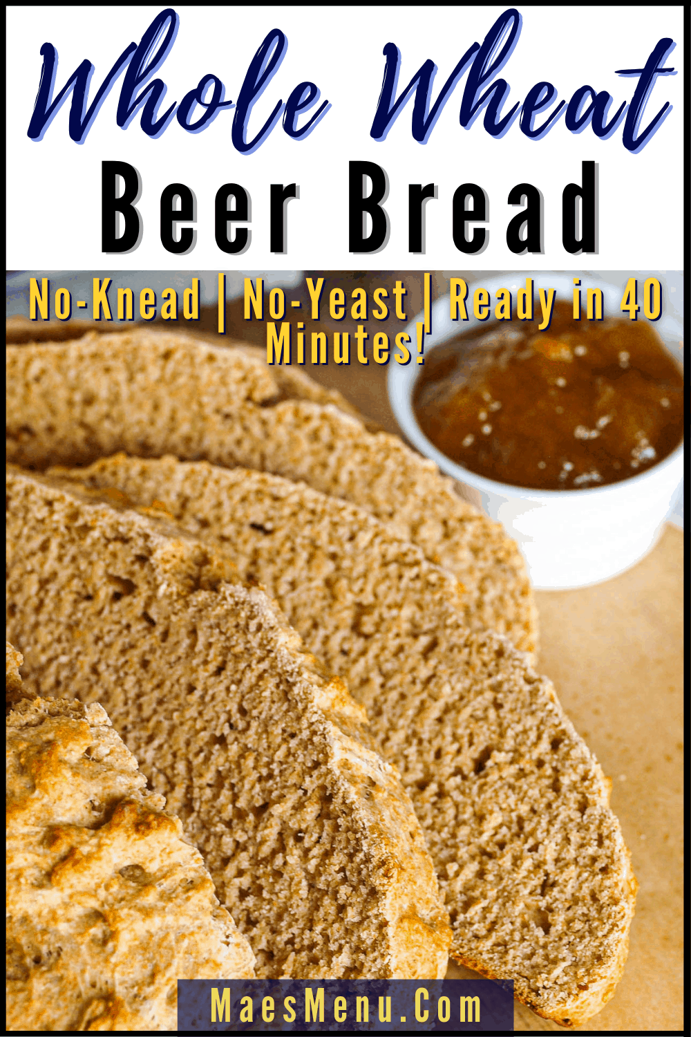 A pinterest pin for whole wheat beer bread with an angled shot of a sliced loaf of whole wheat beer bread on a sheet of parchment paper