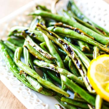 A side angled shot of a platter of green beans
