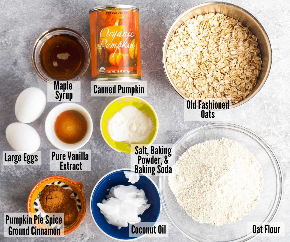 All the ingredients for gluten-free pumpkin cookies: maple syrup, canned pumpkin, old fashioned oats, salt, baking powder, baking soda, oat flour, coconut oil, pumpkin pie spice, ground cinnamon, pure vanilla extract, large eggs