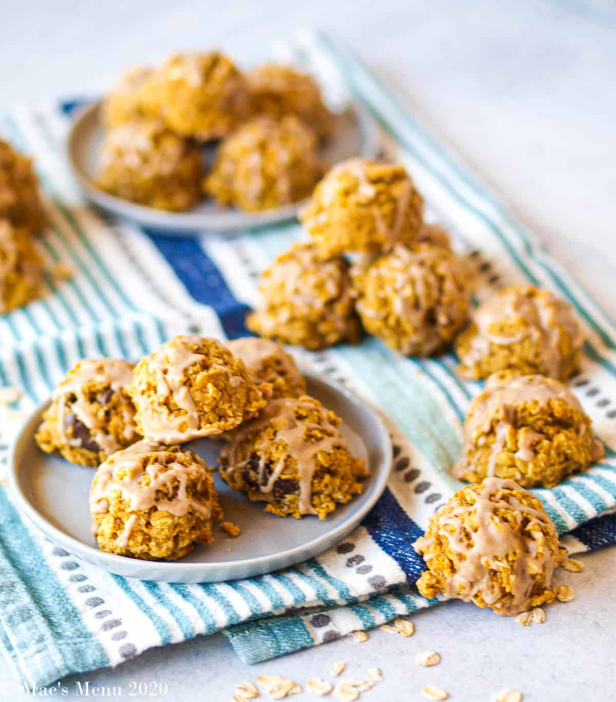 Gluten-free oatmeal pumpkin cookies on a towel and 2 small dishes
