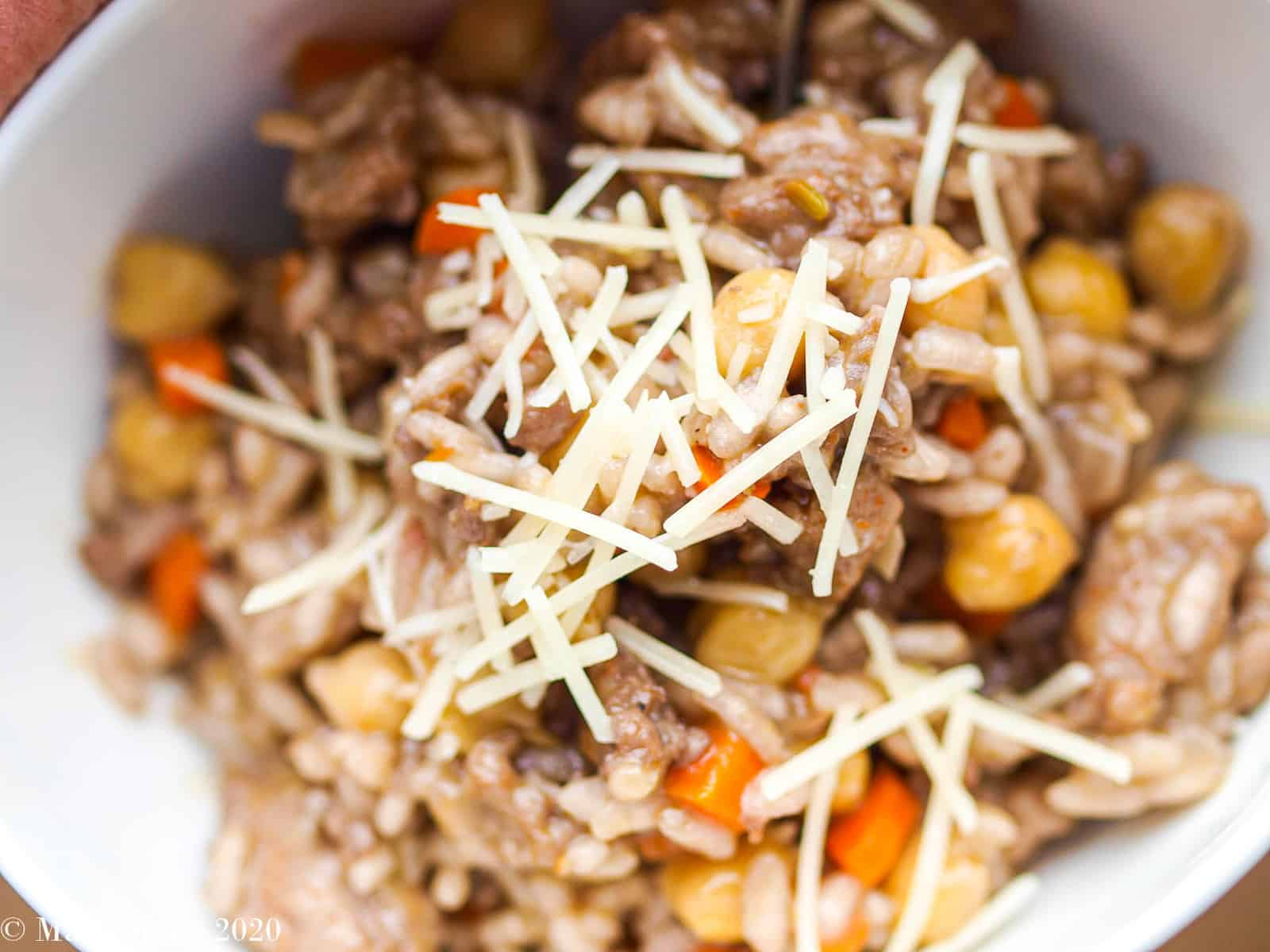 An up-close overhead shot of a bowl of sausage risotto