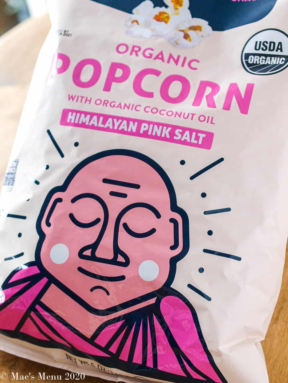 An up-close shot of a bag of lesser evil himalayan pink salt popcorn.