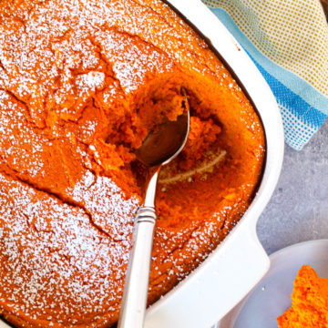 An overhead shot of a carrot souffle w a scoop taken out