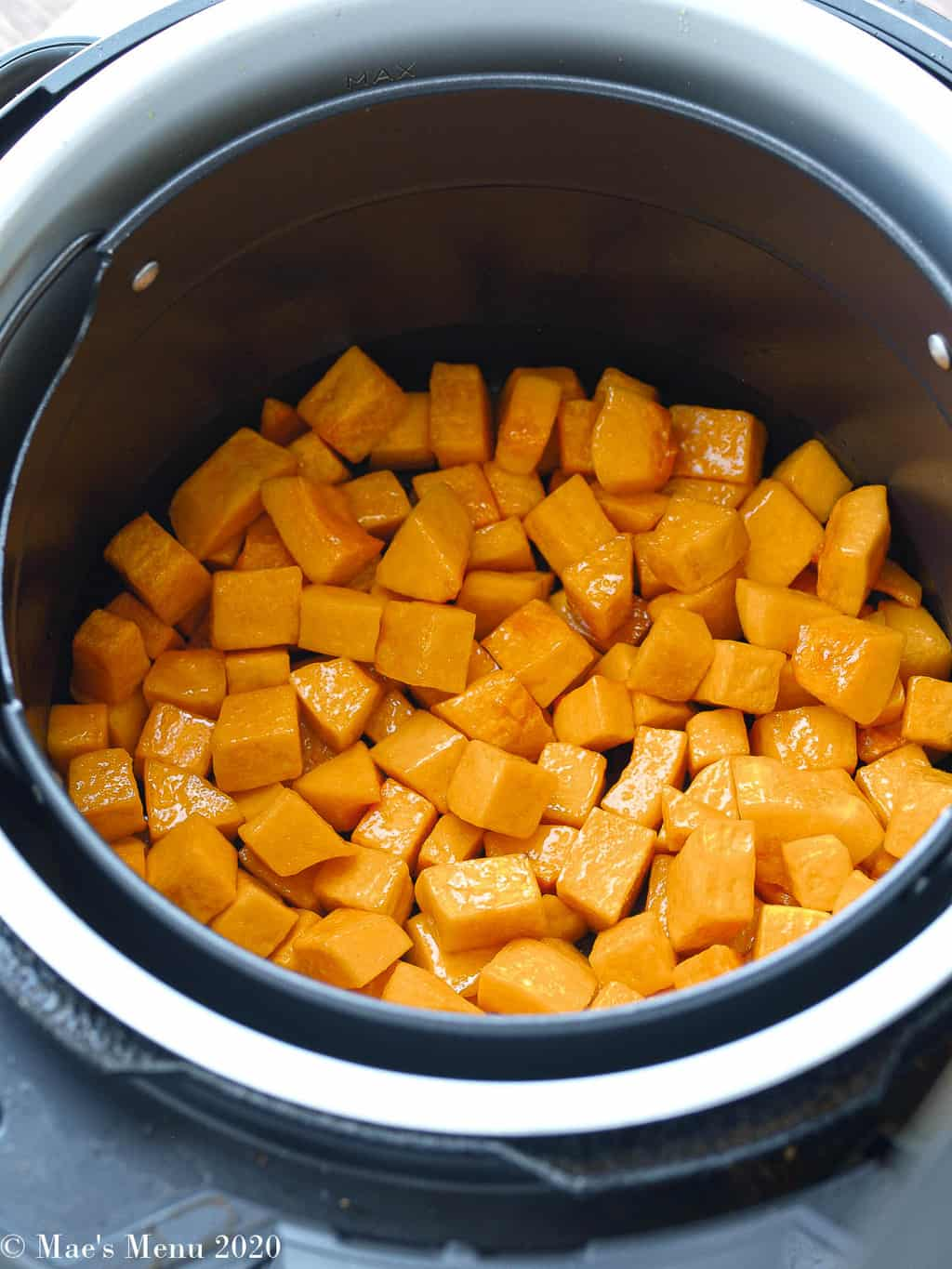 Butternut squash in the basket of an air fryer