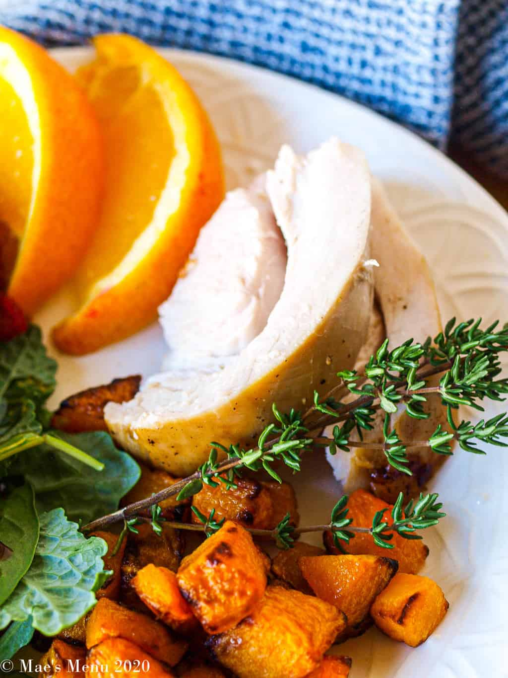 A plate of thanksgiving turkey with air fryer butternut squash on it