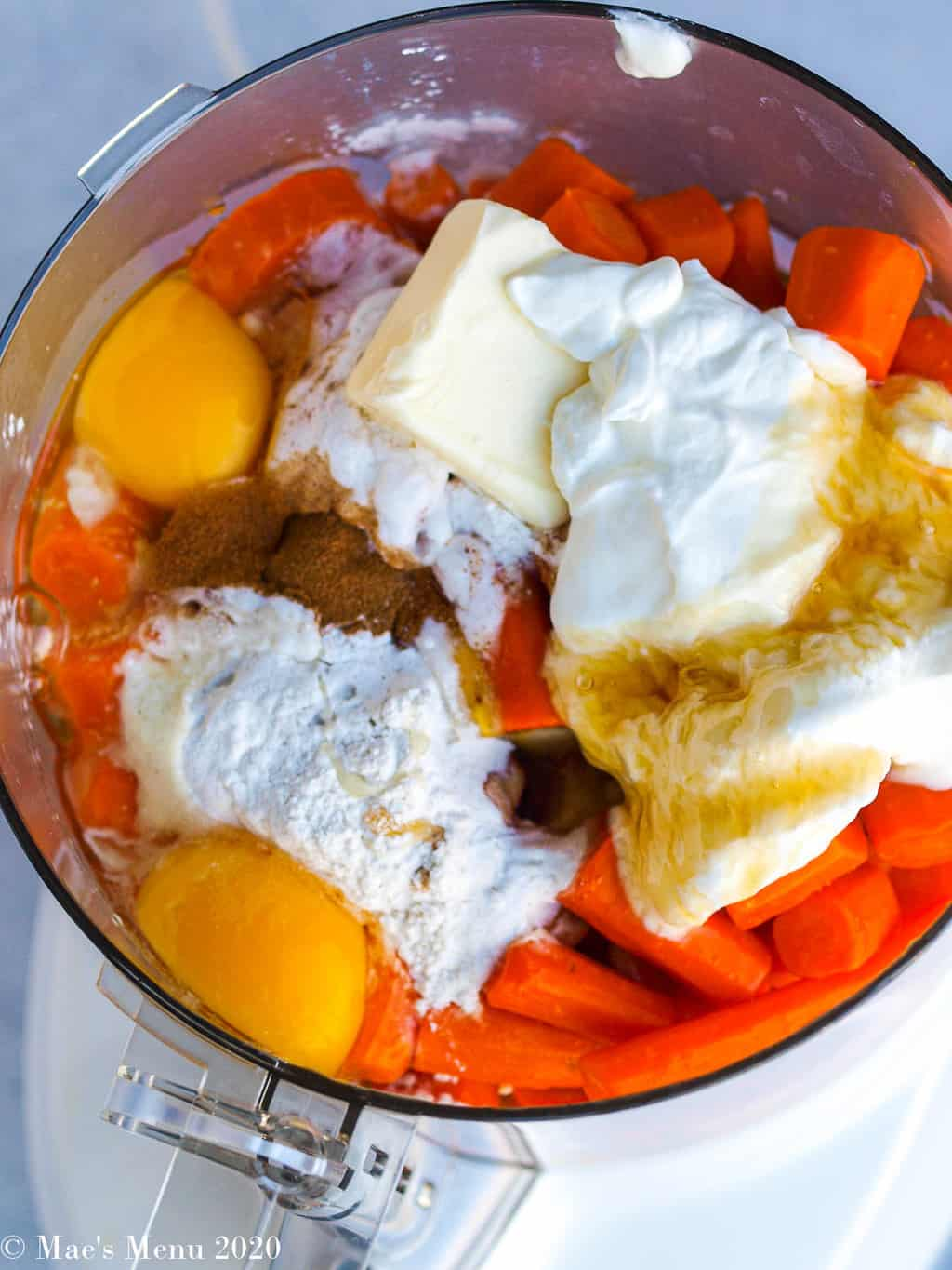 All of the carrot souffle ingredients in the bowl of the food processor