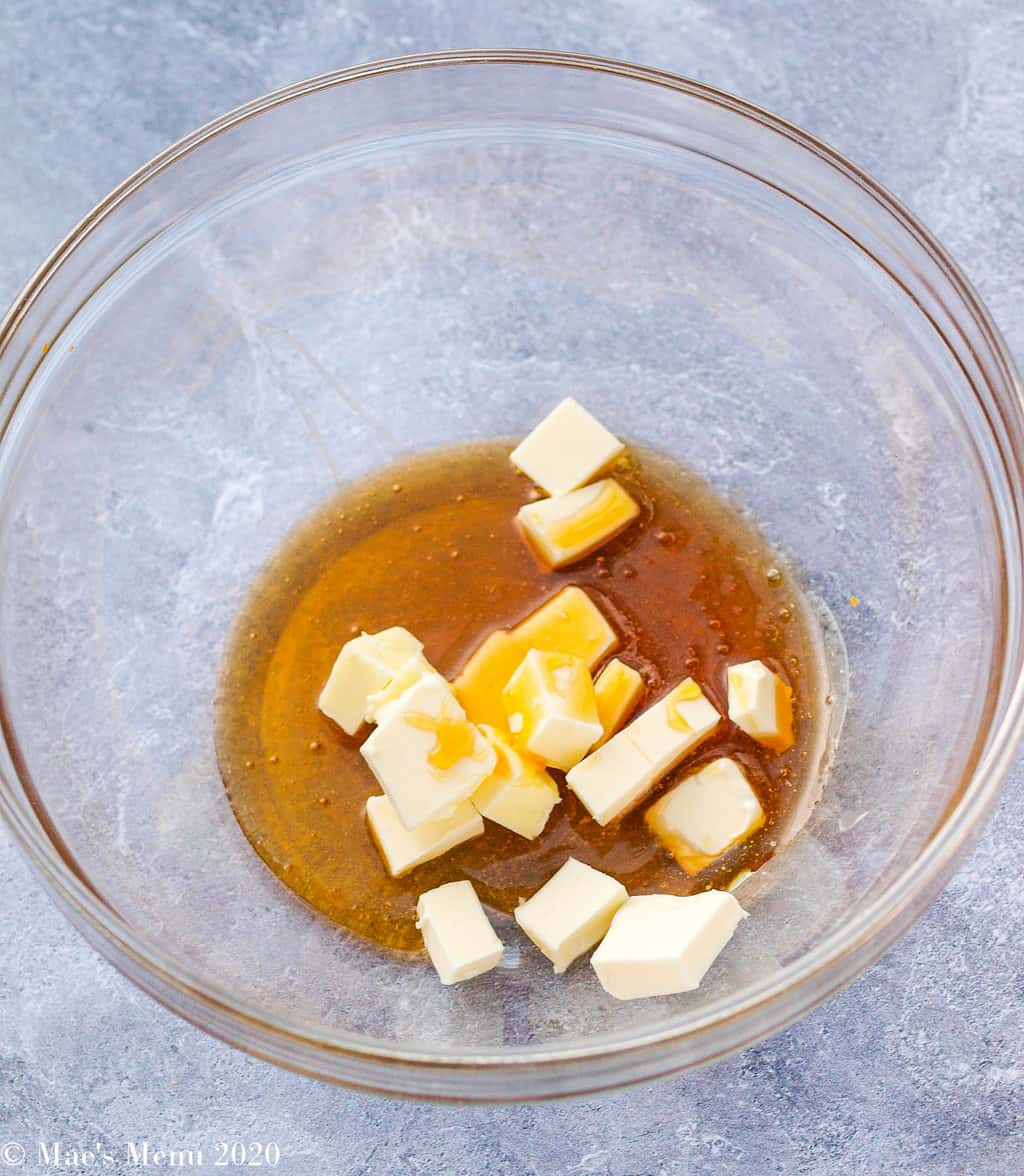 Cubed butter and honey in a large glass bowl