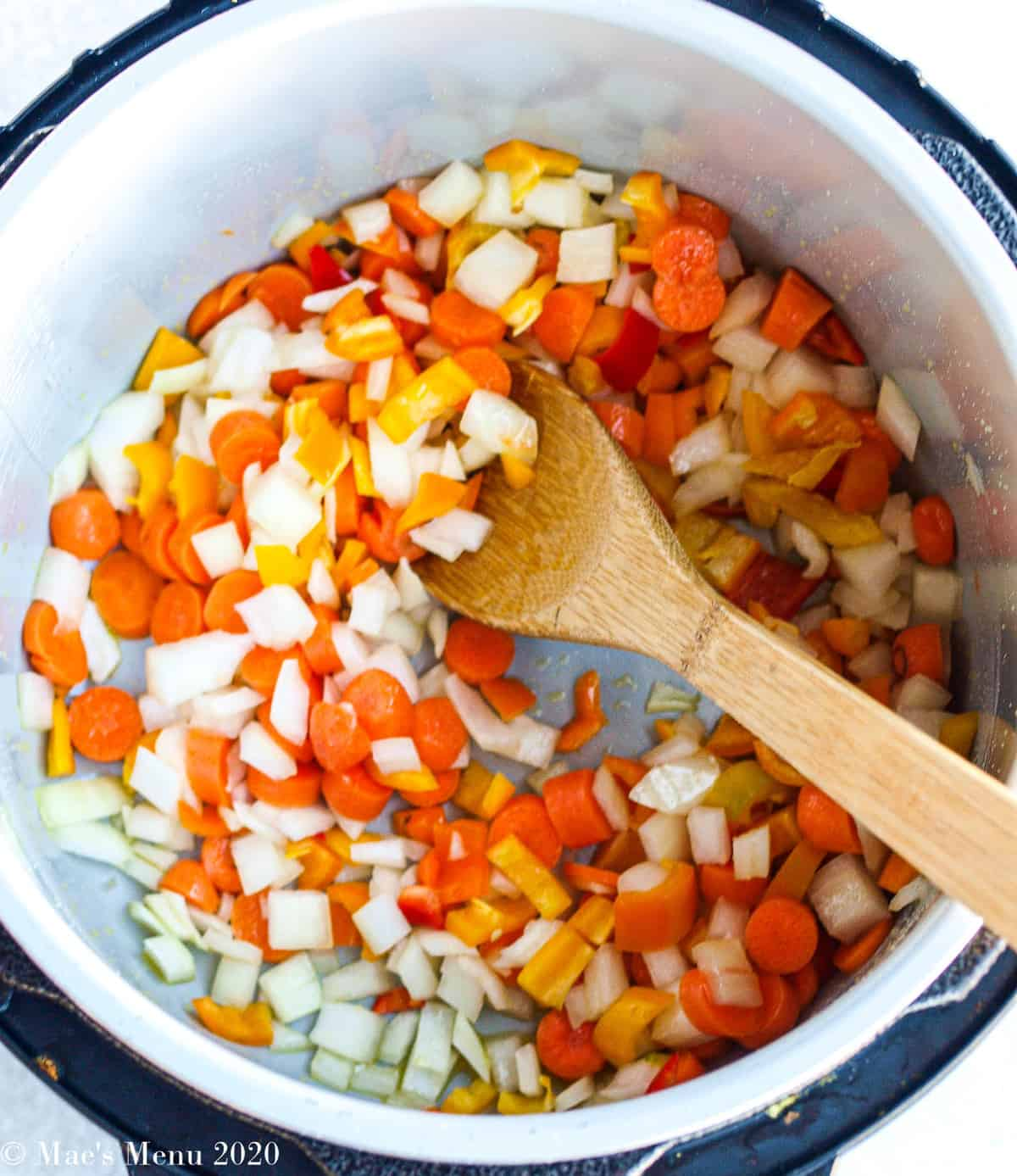 Sauteing peppers, onions, carrots, and celery in an instant pot
