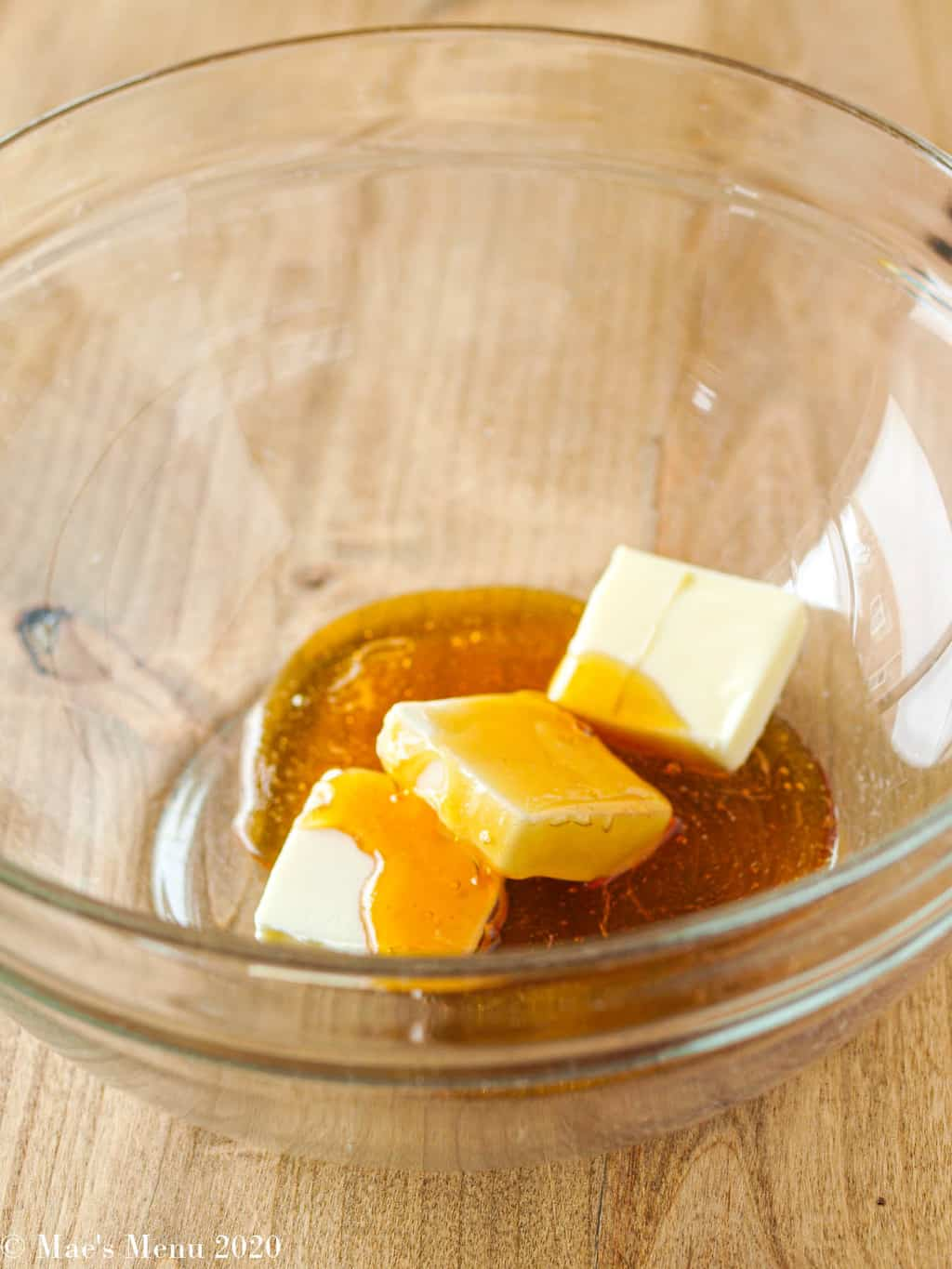 Butter and honey in a mixing bowl