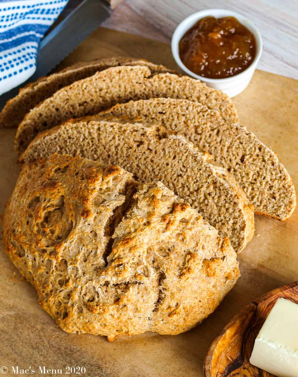 An angled shot of a sliced loaf of whole wheat beer bread