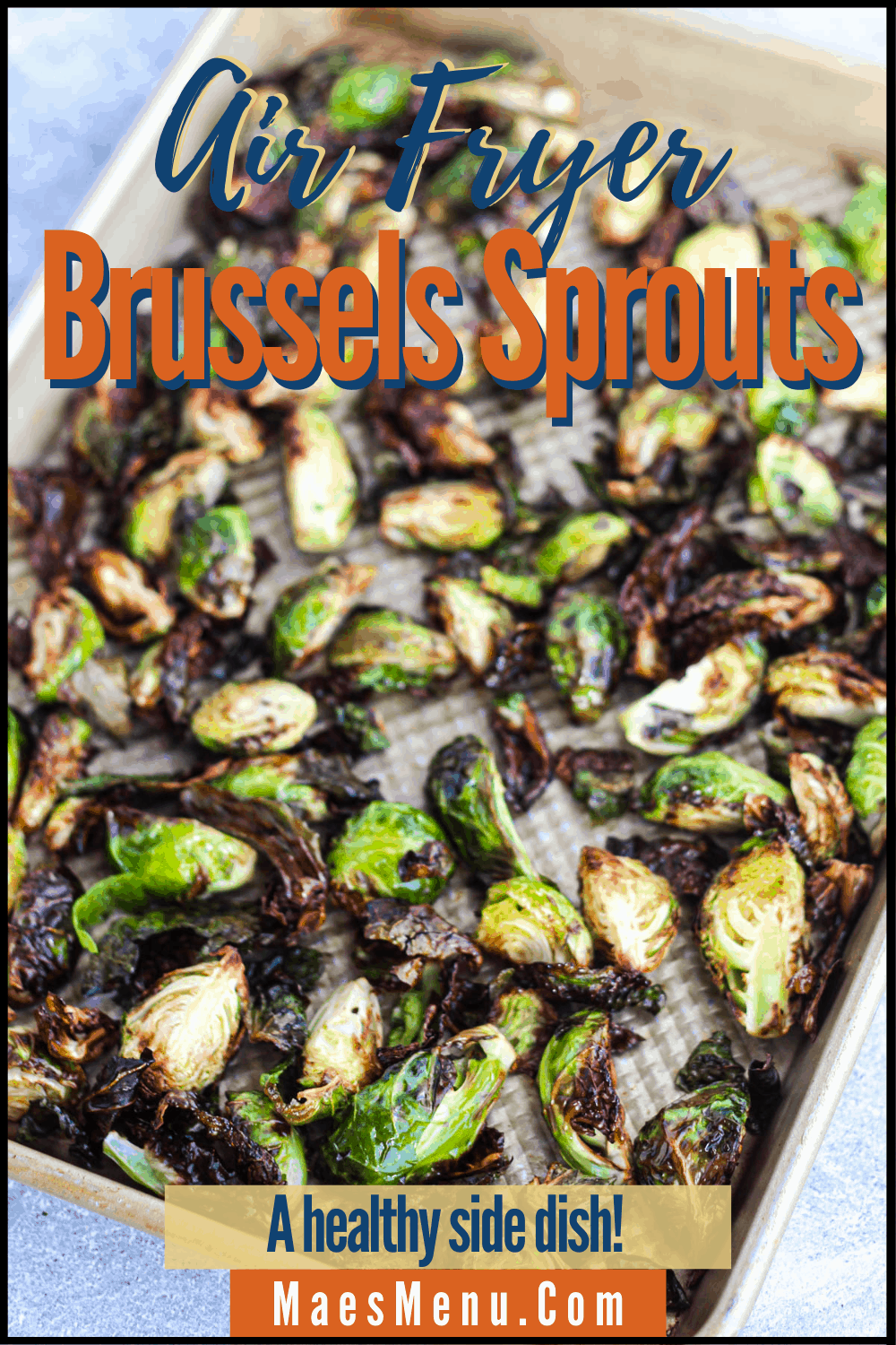 A pinterest pin for air fryer butternut squash. On the image is a  sheet pan full of the fried brussels