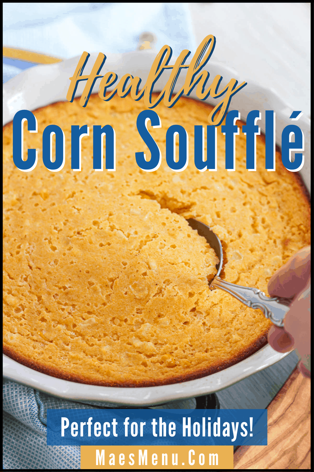 A pin for healthy corn souffle with a hand scopping into the baking pan of the souffle. on the bottom of the pin reads