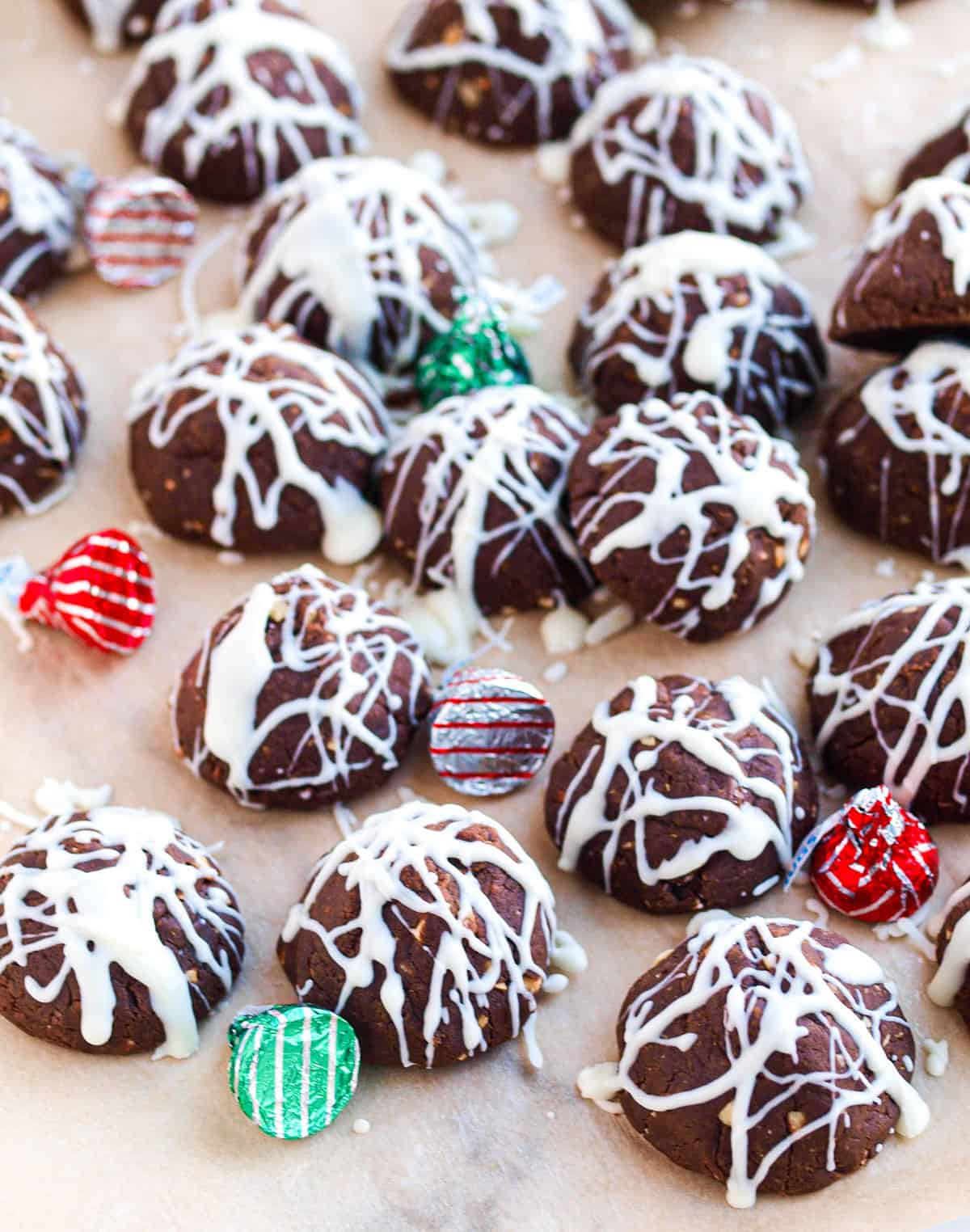A pile of fudgy bonbons on a piece of parchment  paper with hershey's hugs between them