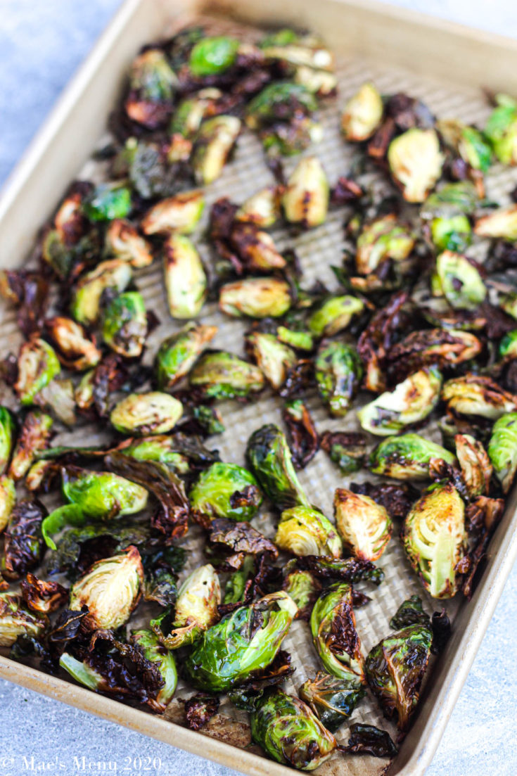 A large gold pan of air fryer brussels sprouts