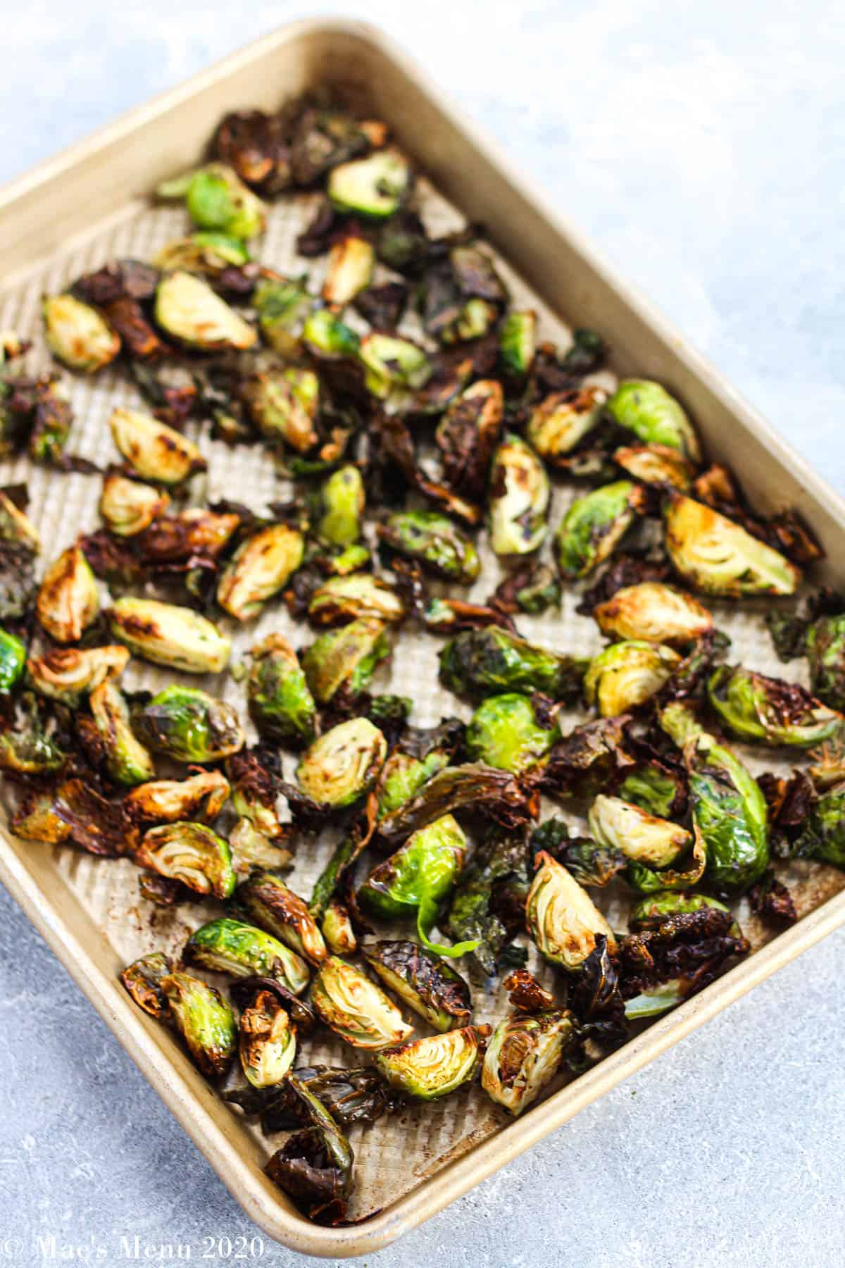 An angled overhead shot of a pan of air fryer brussel sprouts