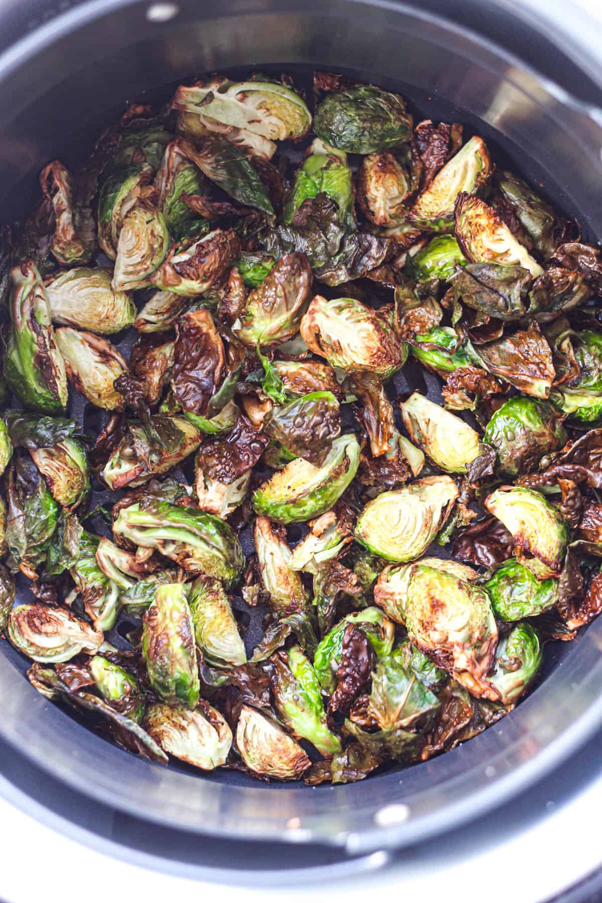 Air fryer brussels sprouts in a roasting basket