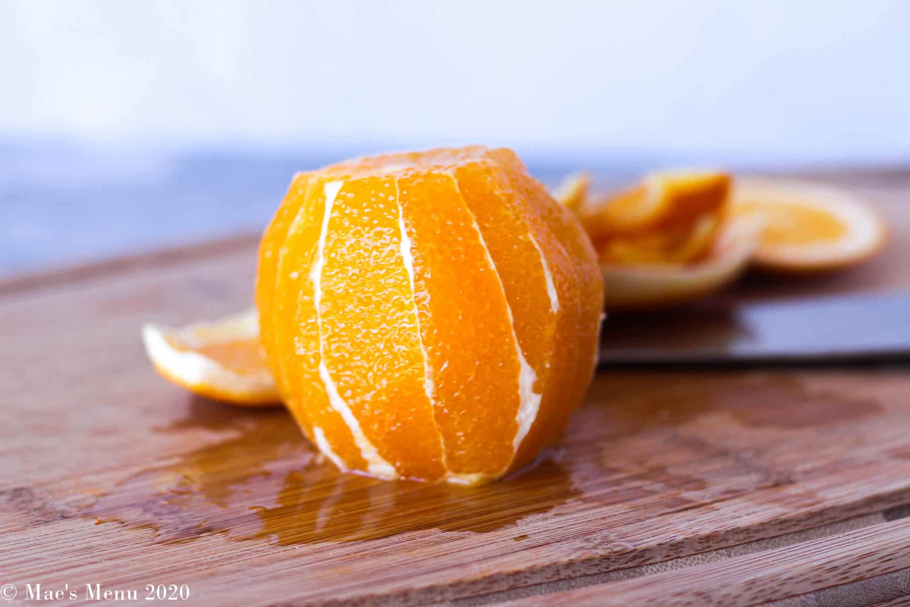An orange with the peel sliced off