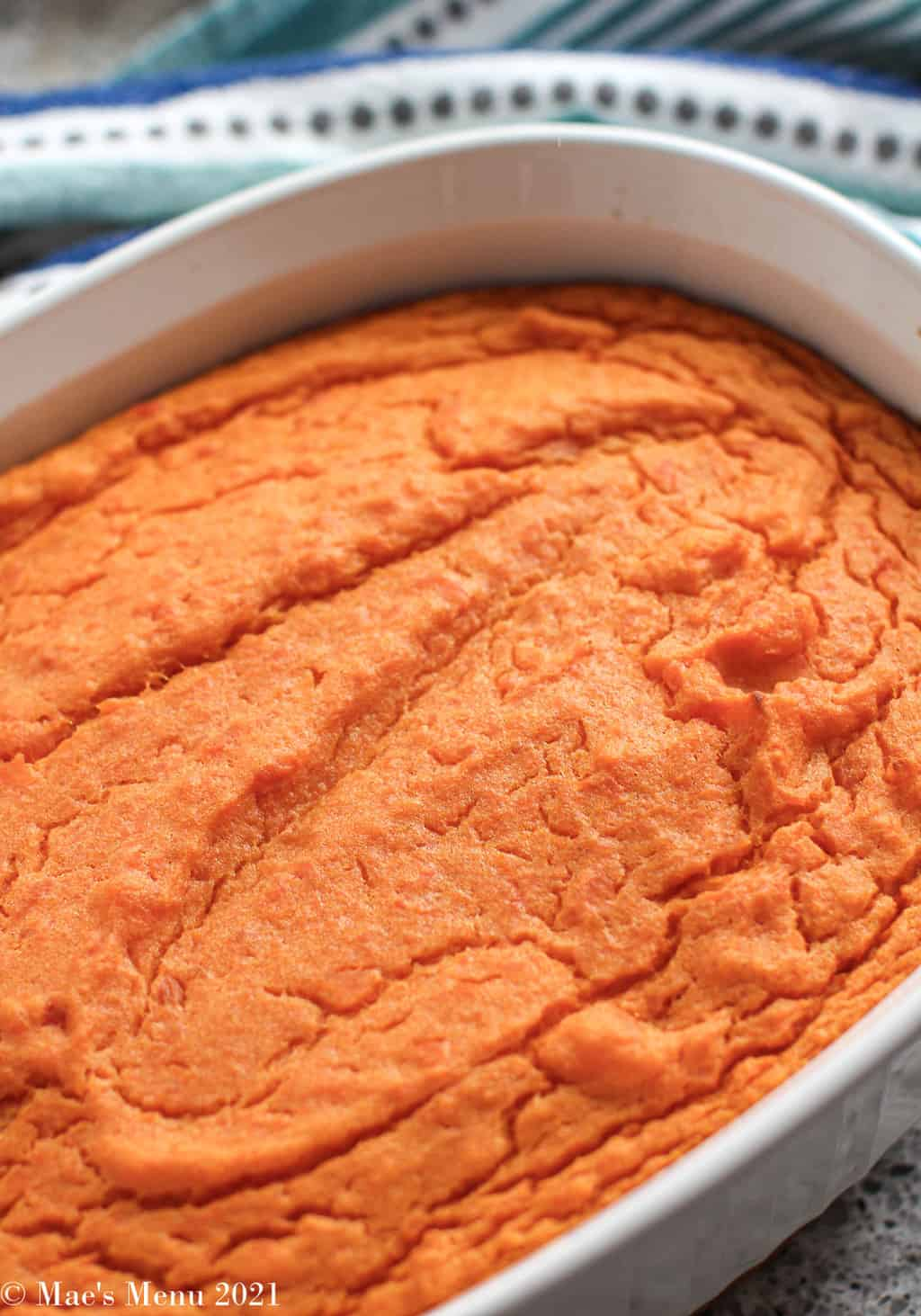 An up-close overhead of a casserole dish of the sweet potato souffle