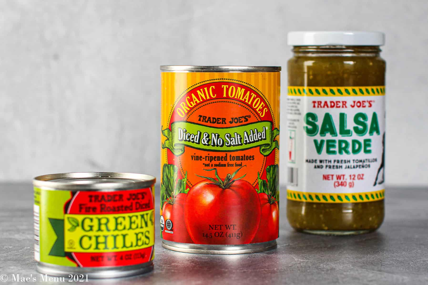 A can of green chili, diced tomatoes, and salsa verde