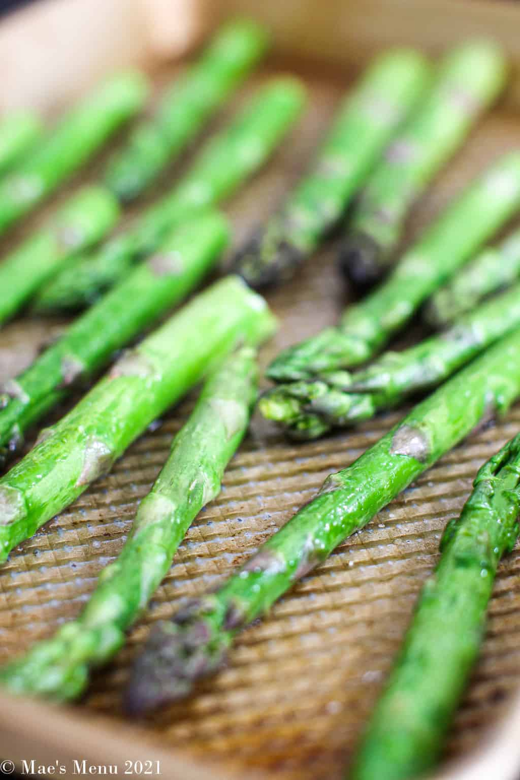 Freshly roasted asparagus on a baking sheet