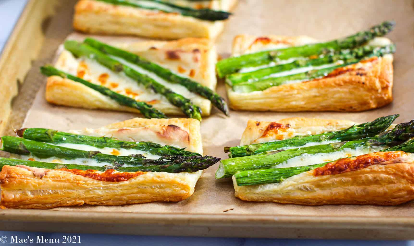 A side shot of a tray of asparagus tarts