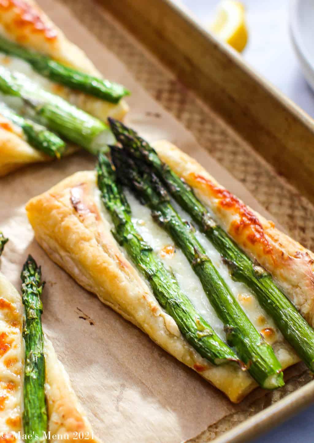 An up-close angled shot of a cheesy asparagus tart