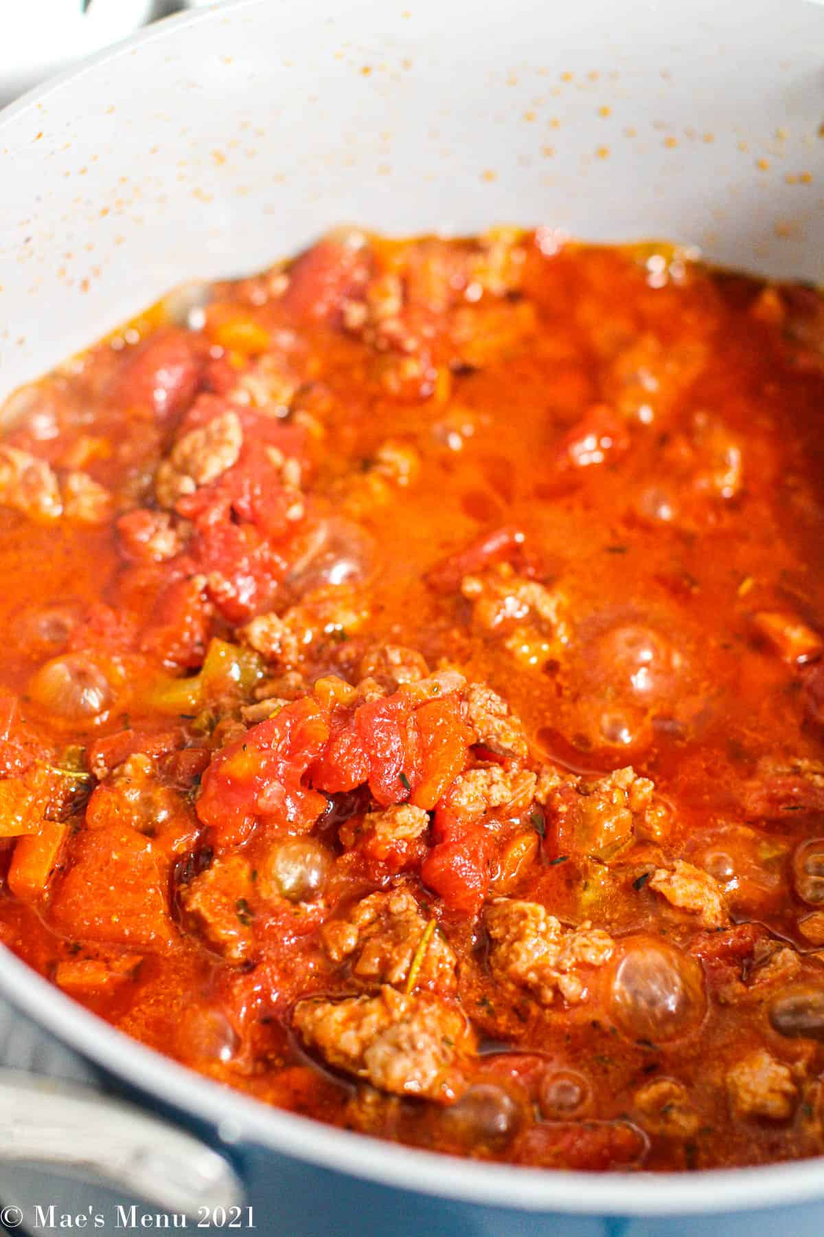 Chicken bolognese simmering in a large stockpot