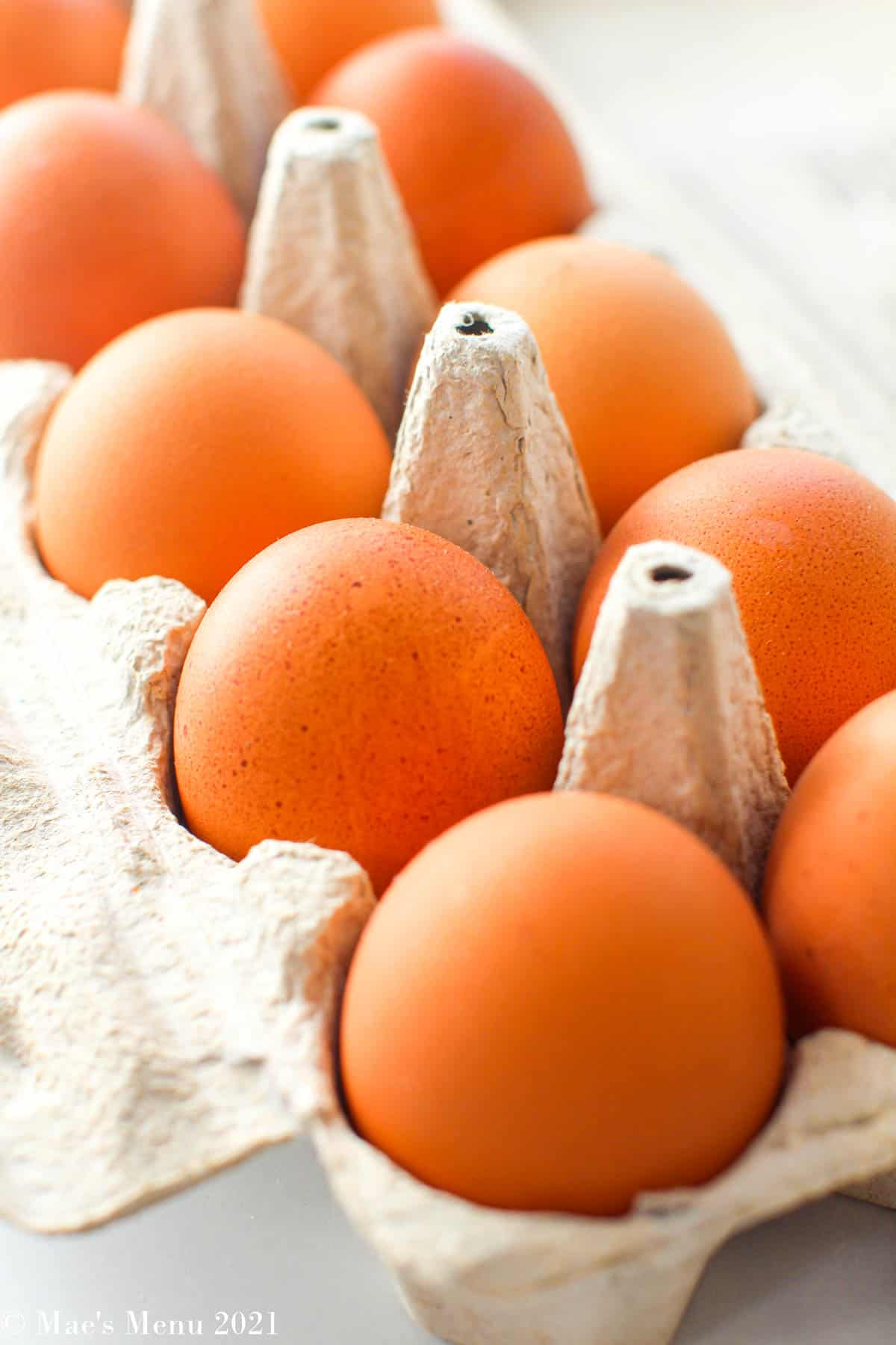 A side angle shot of a crate of eggs