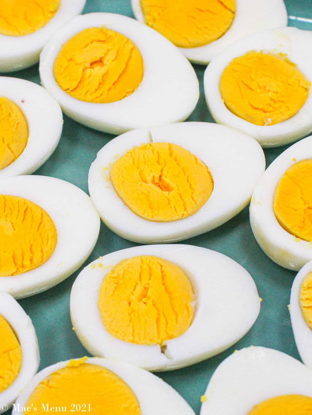 An overhead shot of hard boiled eggs cut length-wise