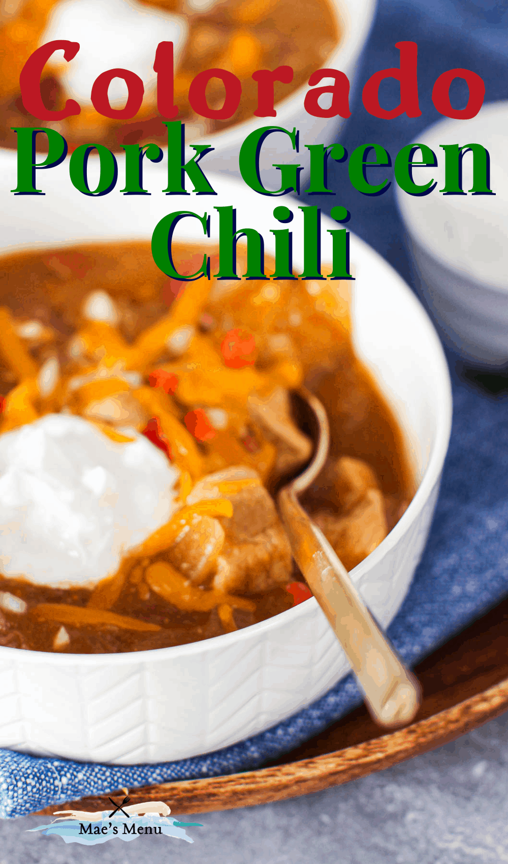 """colorado pork green chili"" with an up-close photo of a spoon in a bowl of chili"