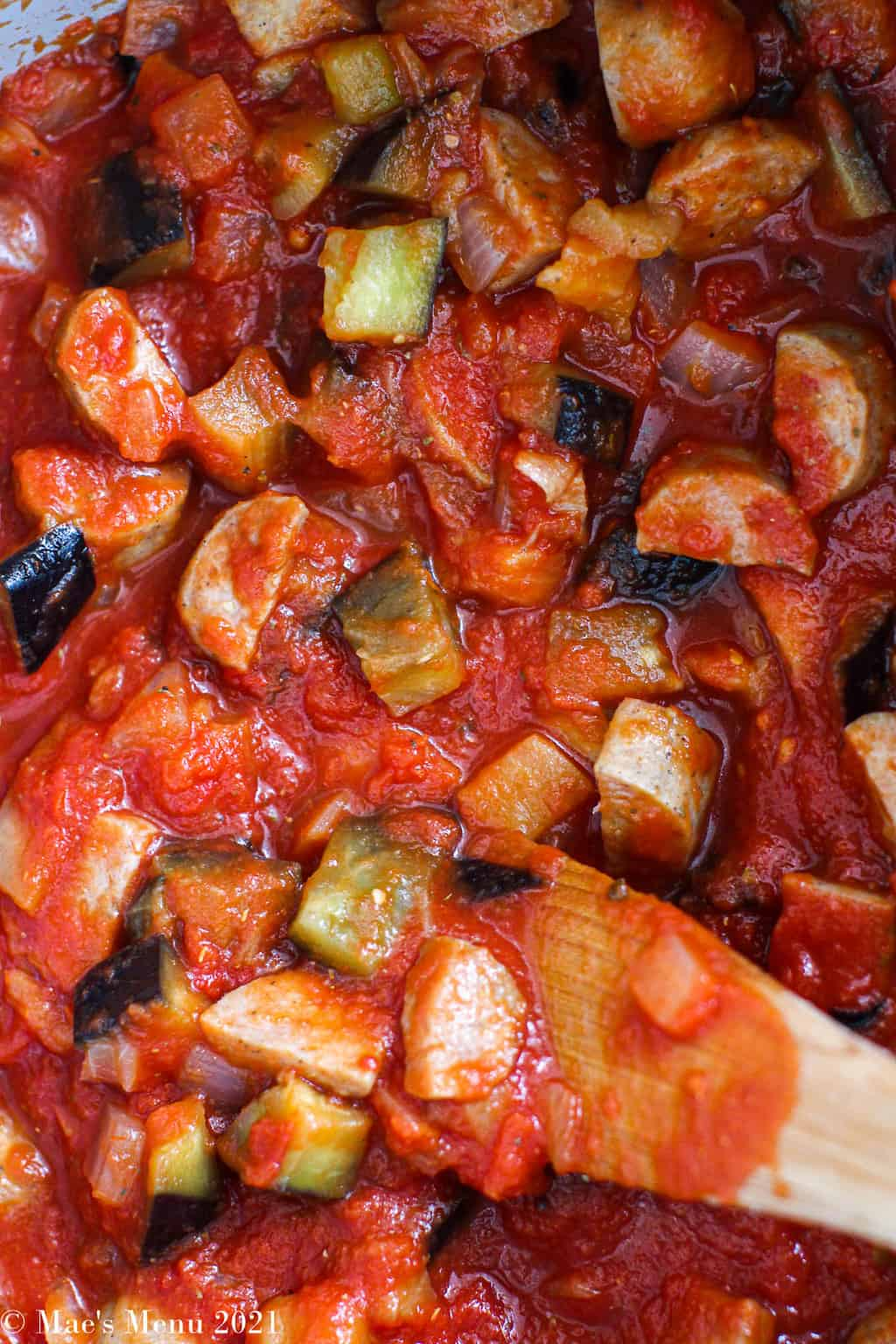 an up-close overhead shot of the tomato sauce with sausage and eggplant