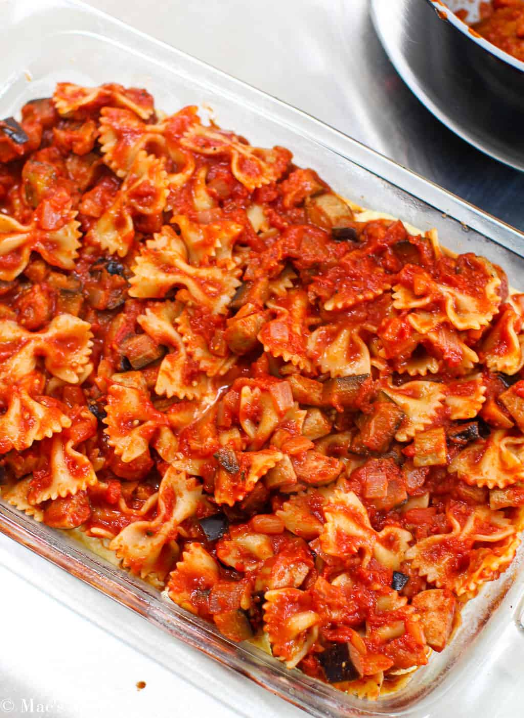 A baking pan with the tomato pasta in it