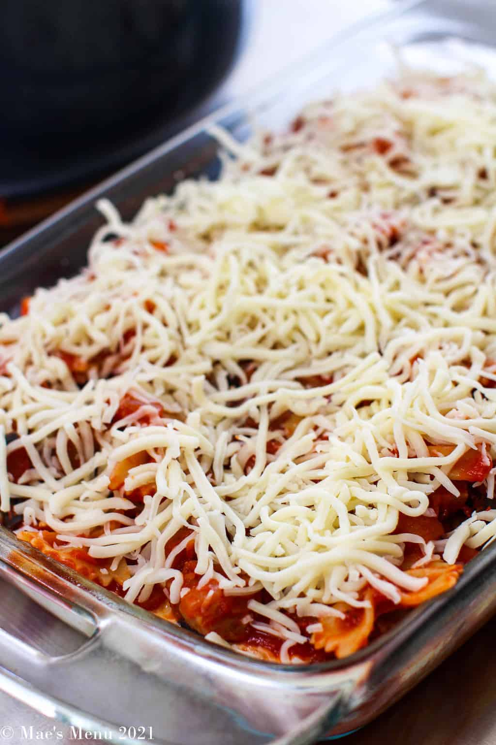 Shredded mozzarella on top of the pasta bake before going in the oven
