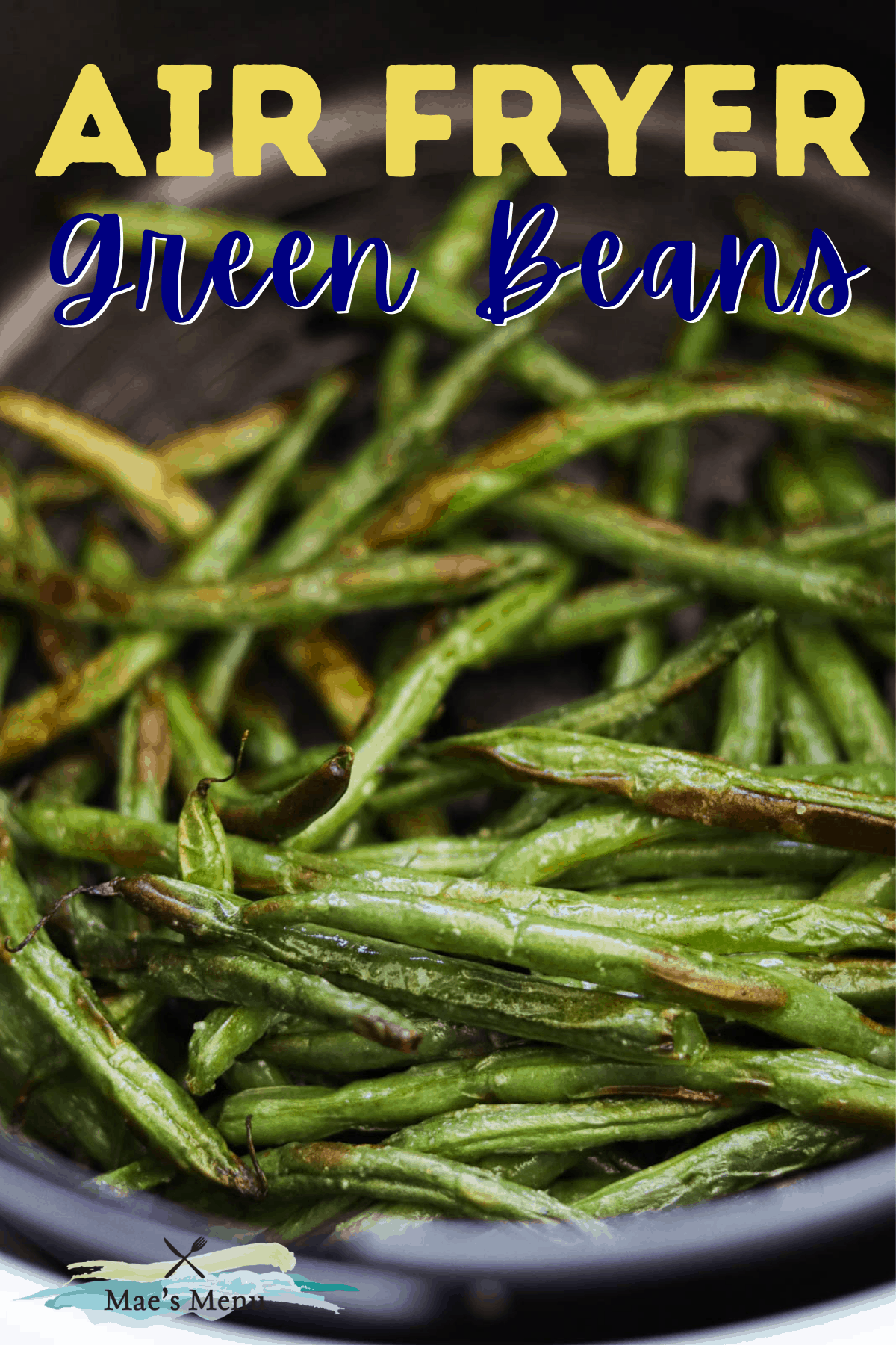 A pinterest pin for air fryer green beans with an up-close overhead shot of the beans in an air fryer basket