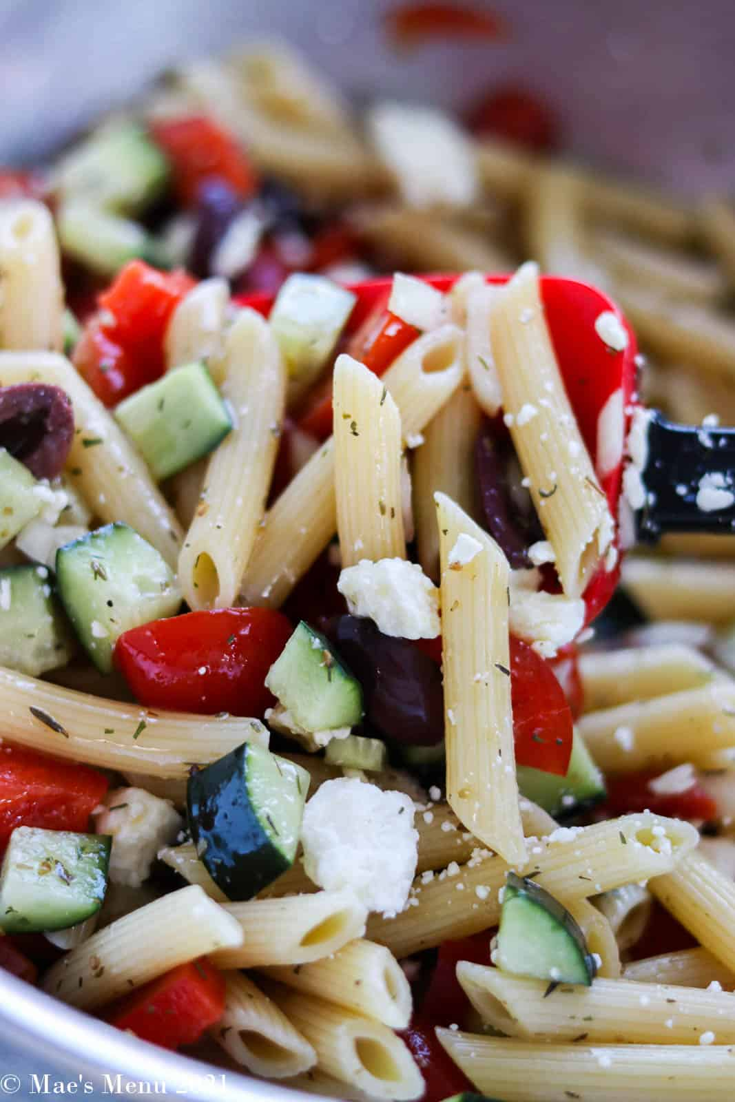 Folding the feta cheese into the vegetable and pasta mixture