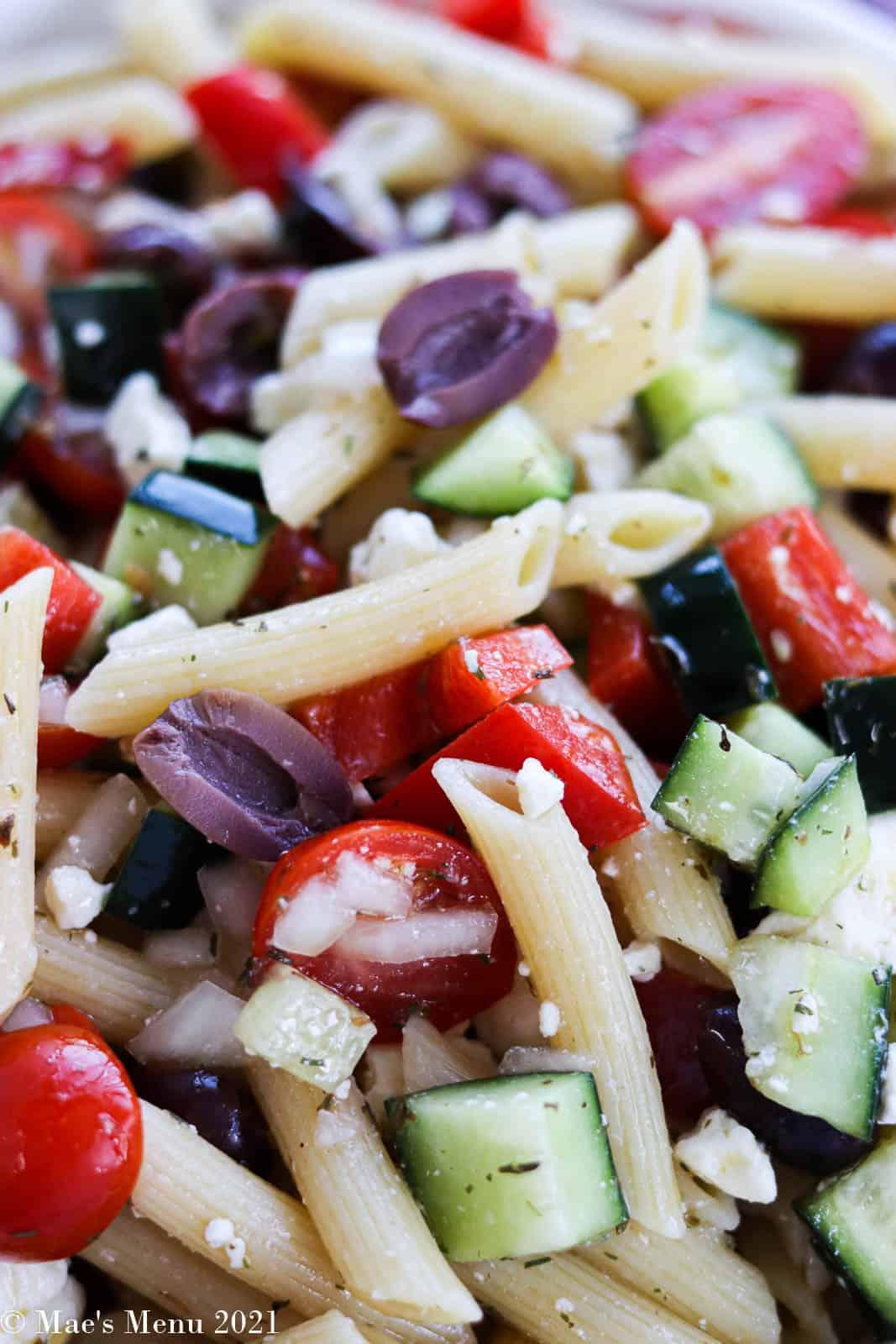 an up-close shot of a bowl of Greek pasta salad