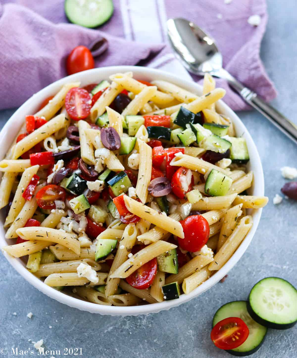 An overhead shot of a bowl of Greek Penne pasta salad