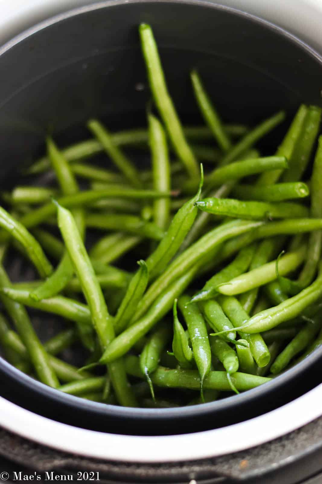 Green beans in the air fryer basket