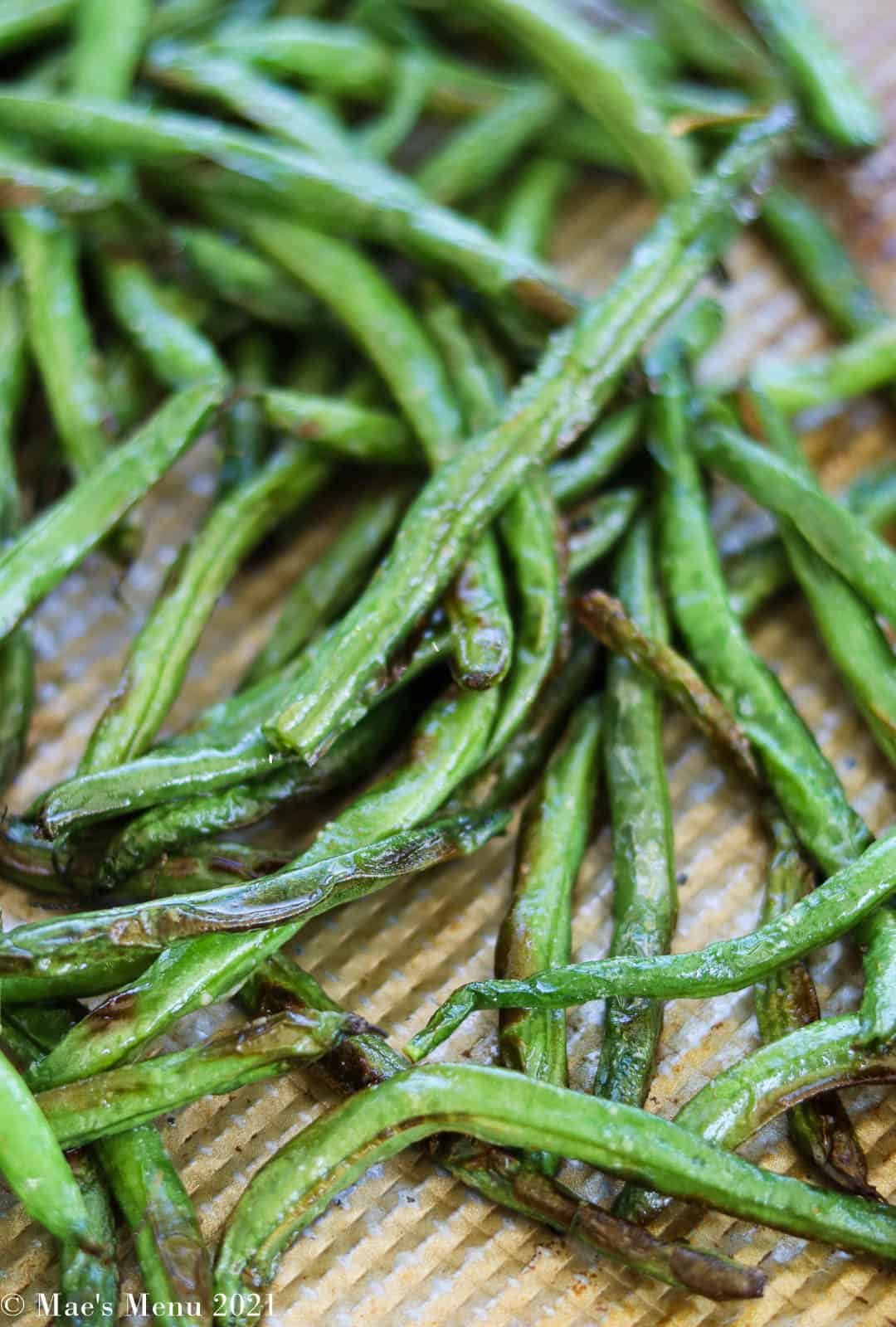 An up-close overhead shot of a tray of air fryer green beans