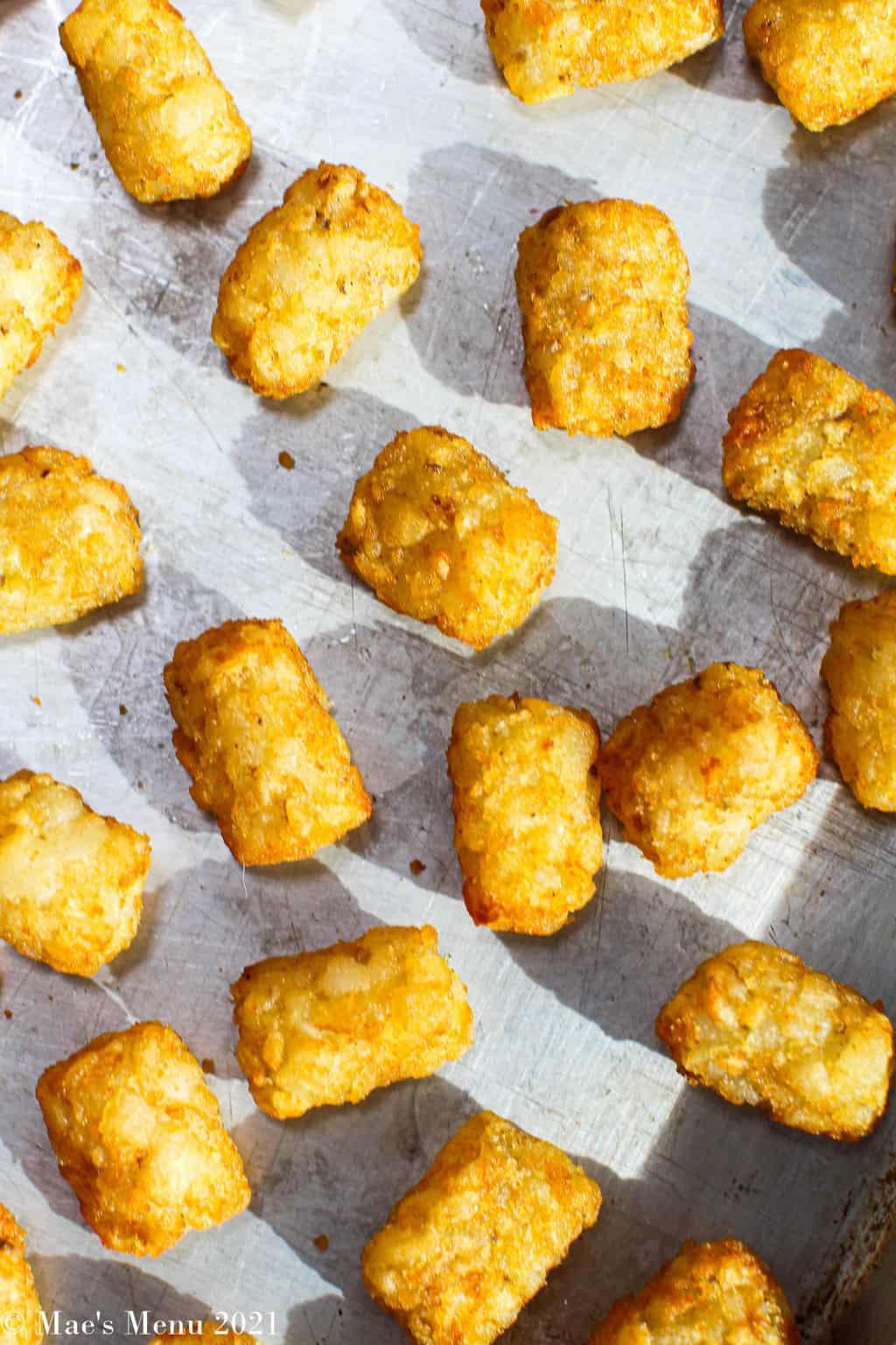 air fryer tater tots on a baking sheet