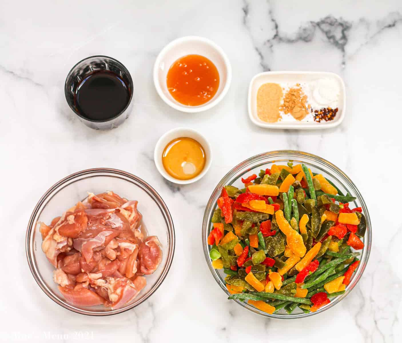 All the ingredients for the chicken with stir fried froze vegetables