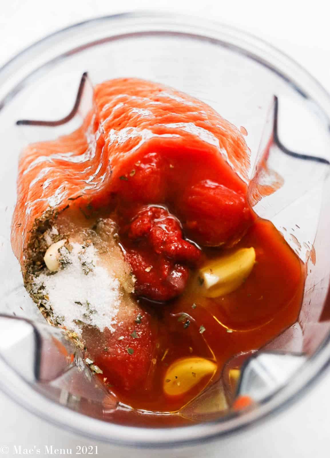 Marinara sauce ingredients in a blender
