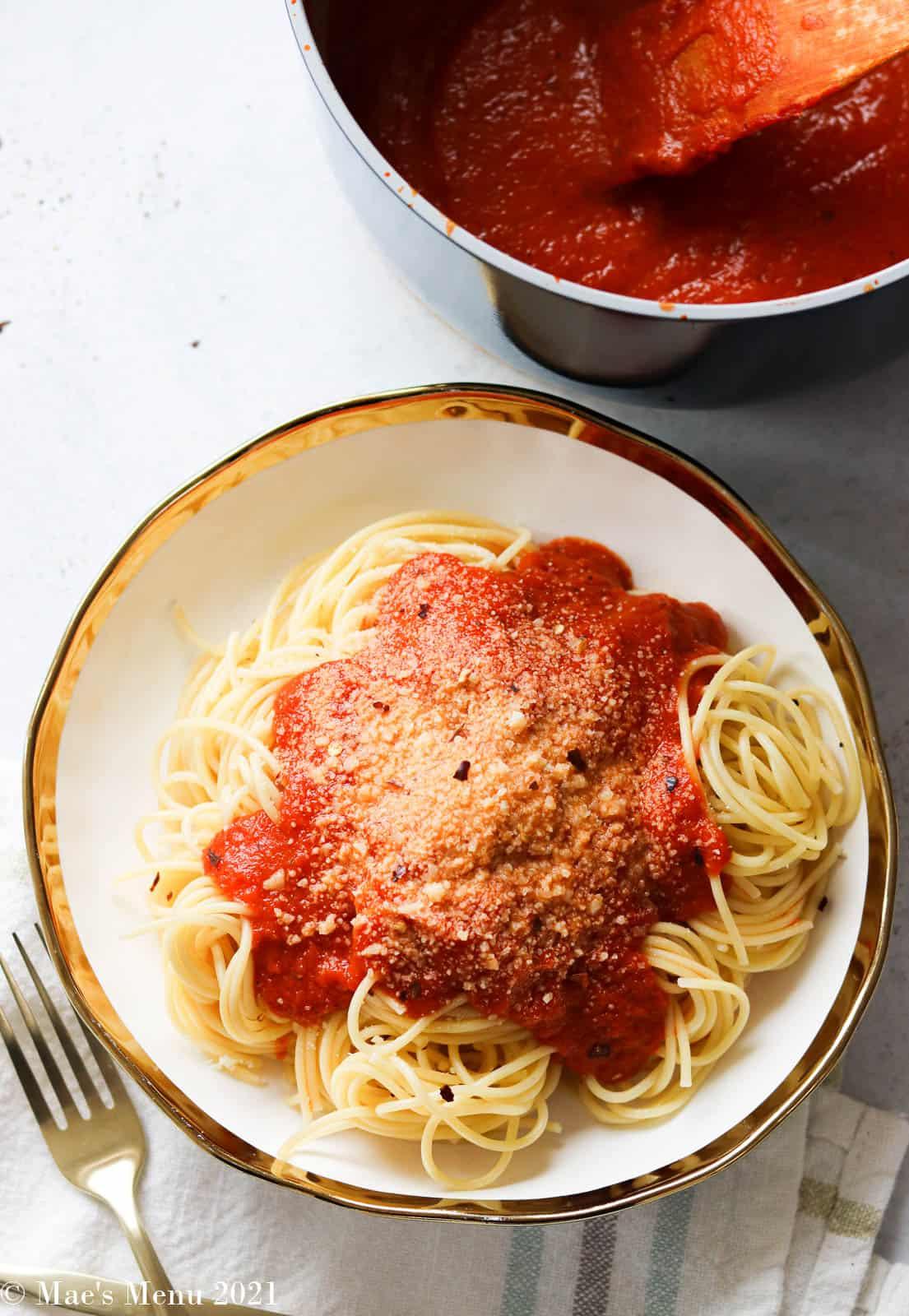 An overhead shot of a bowl of pasta with homemade marinara sauce.
