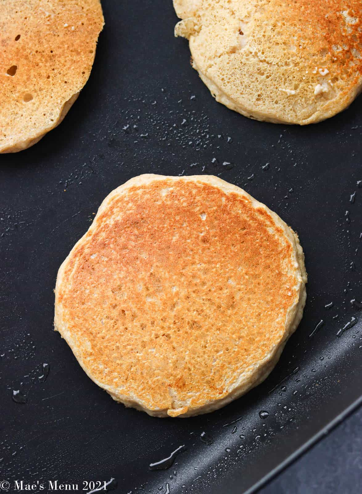 Cooked pancakes on a griddle